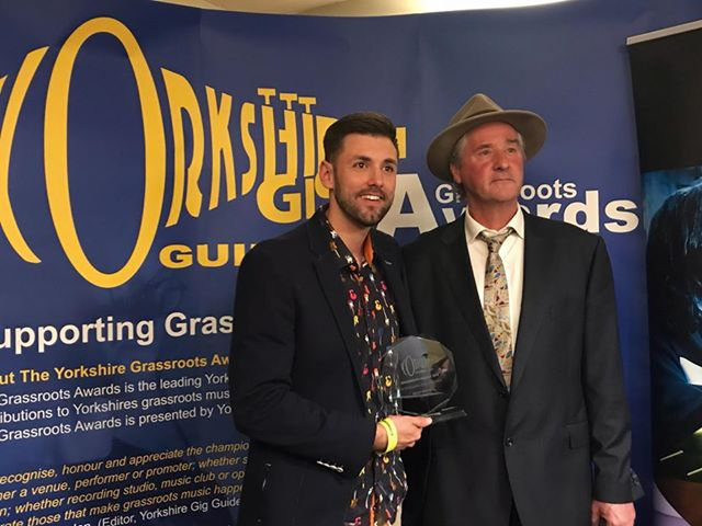 Ryan Swain receiving his award from Yorkshire Gig Guide