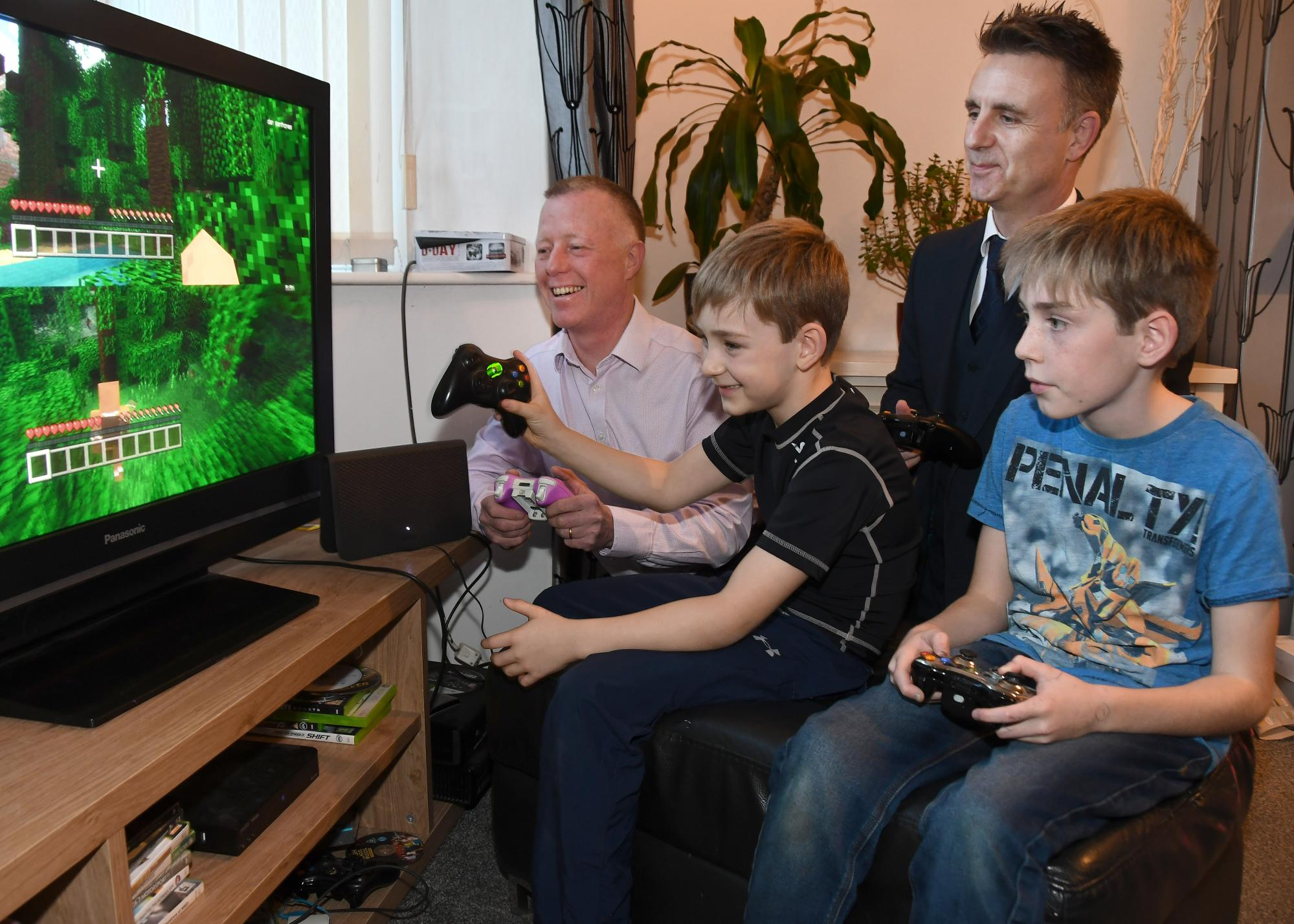 Paul Crane, TalkTalk, plays with James aged 7, Ryan, aged 11, and their father Richard Grayling at their home in Dringhouses (2)